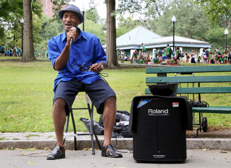 "James Bruce, 53, sings ""Isn't She Lovely"" in the Boston Commons to the passersby. Currently a schoolteacher, while also holding a PhD in business, and owning several businesses, James is a street performer just for fun, stating, ""I just wanted to come in and spread some sunshine!"""