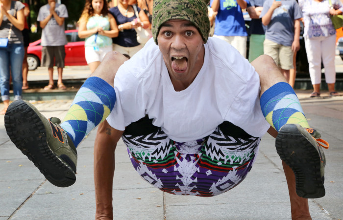 During a breakdance show outside of Faneuil Hall, a street performer from the You Already Know (YAK) Dancing Company poses for a photograph.