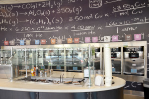 Yogurt Lab serves 16 different flavors of yogurt at a time. Shop decorations include a chalkboard with formulas, continuing its chemistry lab theme.