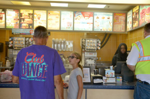 Customers wait for their orders at a busy Dairy Queen the afternoon of Wednesday, August 5, 2015.