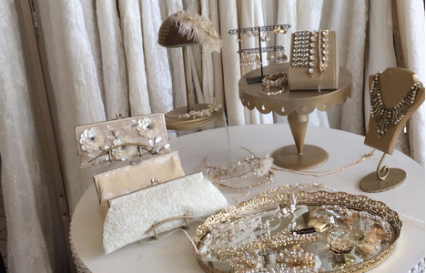 Jewelry made by owner Jennifer Meyer and couture wedding dresses.