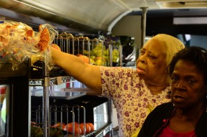 Ethel Kelly and Frankie Forrest shop for peaches in the Mobile Market. Photo by Nicholas Liu
