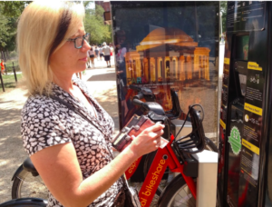 Trish O'donnell pays for her bike rental at a Capital Bike rental station